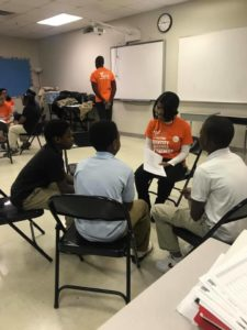 Andrews University student mentoring a group of BHCSA students